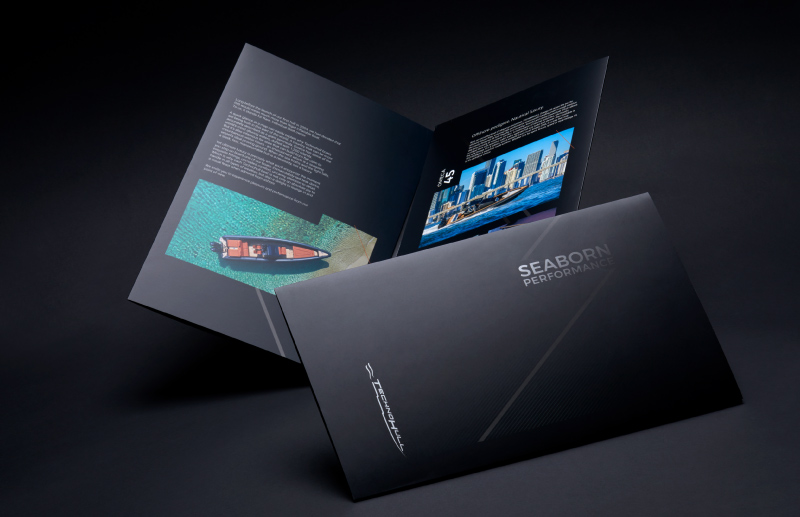 A printed black and coloured brochure design by MDesigners for Technohull